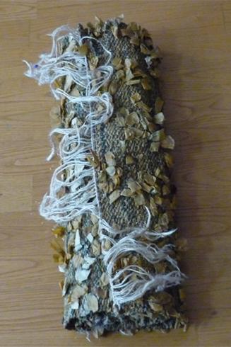 tapis lin et or enroulé